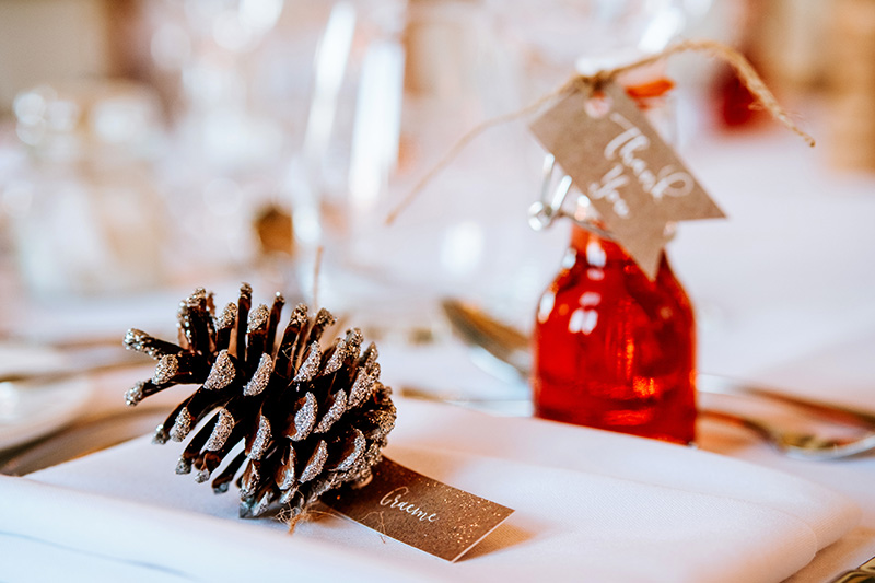 pine-cone-table-place-name-winter-wedding-mythe-barn