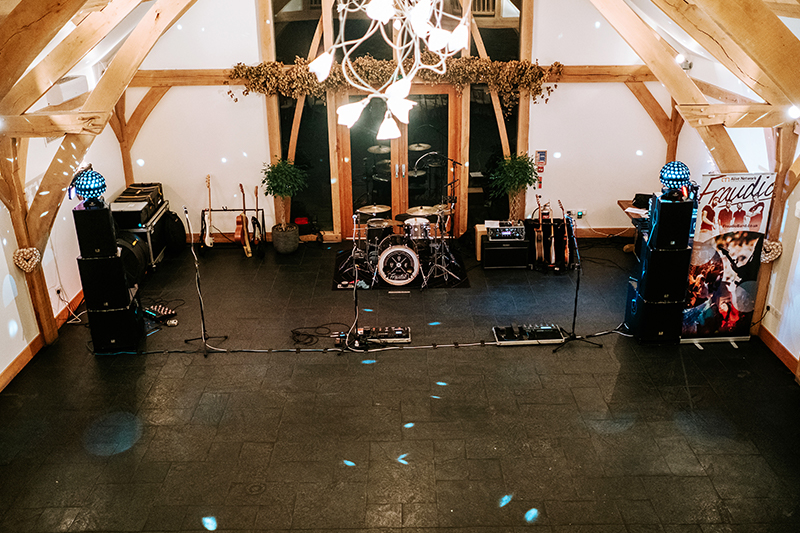 A wedding band is set up in The Oak Barn at Mythe Barn wedding venue in Leicestershire