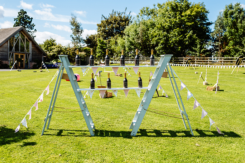 Younger guests can be entertained with garden games on the lawns at Mythe Barn wedding venue in Leicestershire