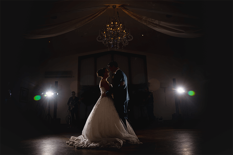 Newlyweds perform their first dance in the Grain Store at Mythe Barn